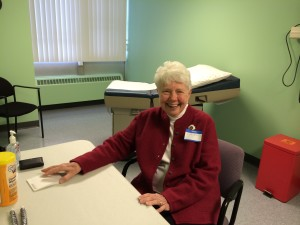 Ruth Stoll in one of the examination rooms at the new Beacon Clinic at 248 Seneca St.