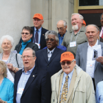 Members of the class of '51 sing their alma mater.