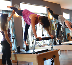Owner Allison Zang (left) instructs a student at Absolute Pilates.
