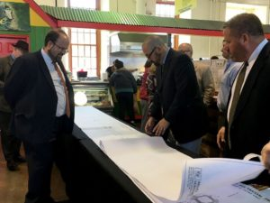Mayor Eric Papenfuse and Andrew Duerr of Wallace Montgomery engineer firm review 3rd Street plans at yesterday's public meeting at the Broad Street Market.