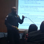 A Harrisburg police officer demonstrates a Taser at last night's city council meeting.