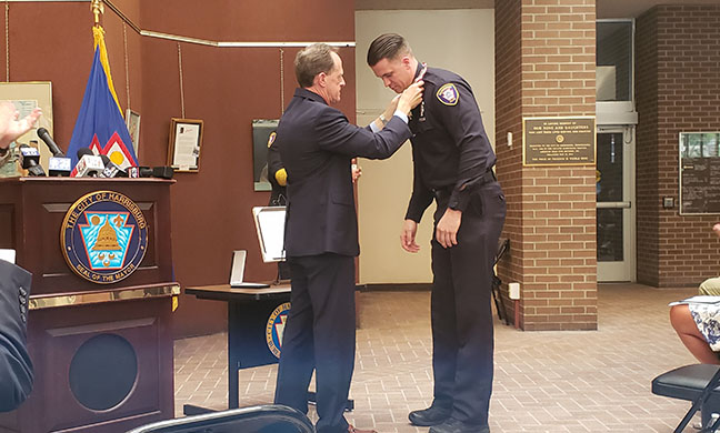 In city hall ceremony, Harrisburg police officer receives